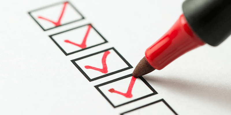 A checklist being filled in with check marks.