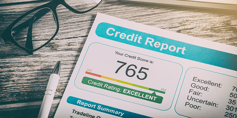 A printed out credit report showing an excellent score of 765