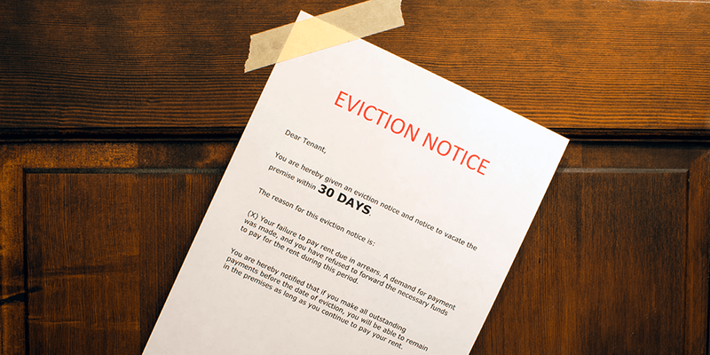 An eviction notice taped to a door.